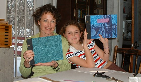 This proud mother-daughter team show their new handmade journals.